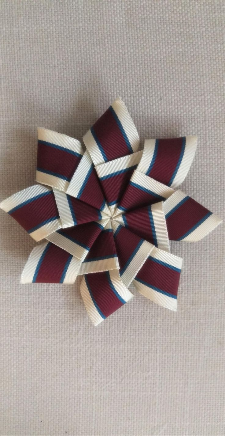 Putting together a small collection of hand made ribbon cockade brooches. Perform to adorn on your winter coat or a gift for an upcoming birday.
