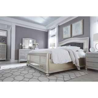 Made with paint grade materials including a stipple look with hardwood solids, with a mid-sheen silver paint finish. The sleigh headboard features wide layered frame with crystal look button tufted cu