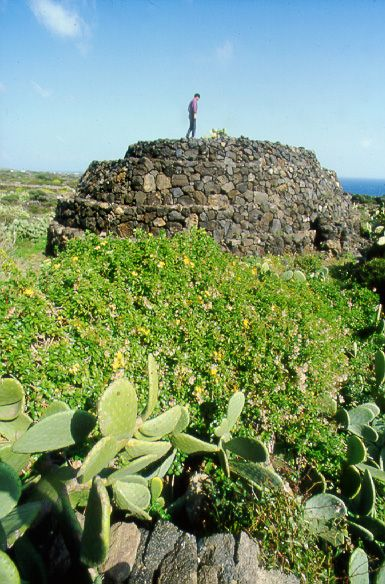 Sese del re, Pantelleria. 5,000 year old Megalithic monument. They are a large number of tombs, known as sesi, consisting of round or elliptical towers with sepulchral chambers in them, built of rough blocks of lava. Fifty-seven of them can still be traced.