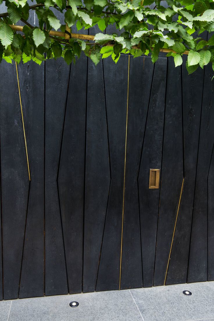 Charred wood in a London court yard. Design by Wilson and McWilliam