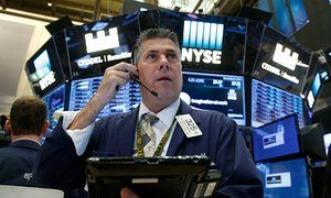 Wall Street cheers peaceful transfer of power after Trump election victory - live https://www.theguardian.com/business/blog/live/2016/nov/09/stock-markets-on-edge-as-us-presidential-election-heads-for-tense-climax?CMP=share_btn_tw A trader works on the floor of the New York stock exchange today.