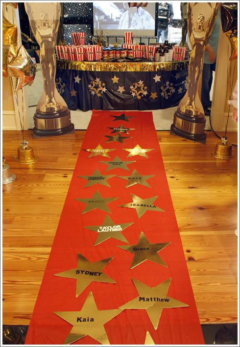 An Oscars themed party would not be complete without a red carpet.  Add a gold star for each guest. #CouchCritics
