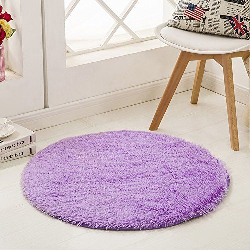 SANMU Super Soft Indoor Modern round Rugs New Arrival Fashion Color for Girls living Room, Bedroom , Parlor Fluffy Silky Smooth Rugs, Mats, round shag rug, Footcloth for Home Decorate. 4 Feet Purple  Material: It is made of polyester. Beautiful color, super soft feeling, the fur is approx 4.12cm high, but you will also feel a little thin and lightweight is because of the softness of the fabrics. Suitable for home decorate, children play mat, women yoga  High quality: No fade.Do not she...