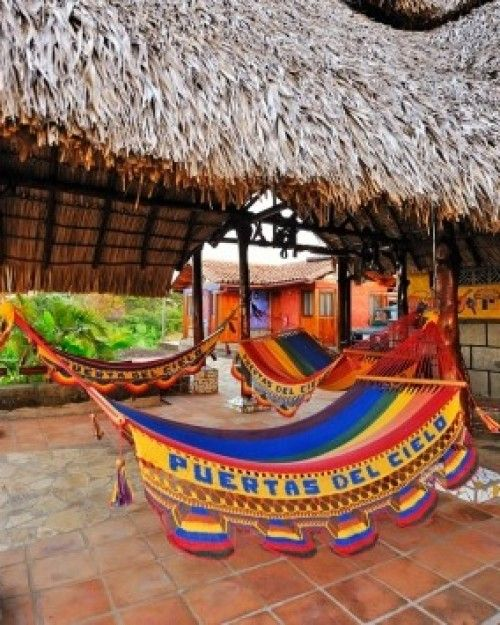 Hacienda Puerta del Cielo  (  Masatepe, Nicaragua )  After adventure tours by day, opt for an afternoon siesta in one of the colorful hammocks. #Jetsetter