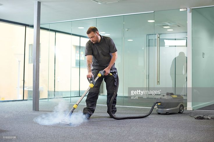 a male cleaning contractor steam cleans an office carpet in a empty office in between tenants. http://perthhomecleaners.com.au/carpet-cleaning/ 863 Hay Street Perth WA 6000 0420 270 260