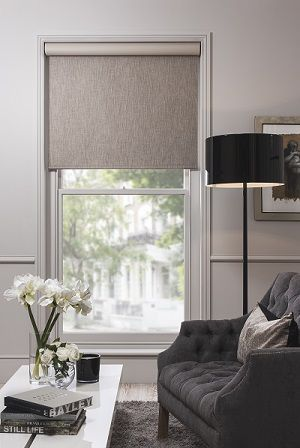 QMotion Roller Blind made with a blackout dark beige fabric from our eclectic range to create that elegant look for your lounge!