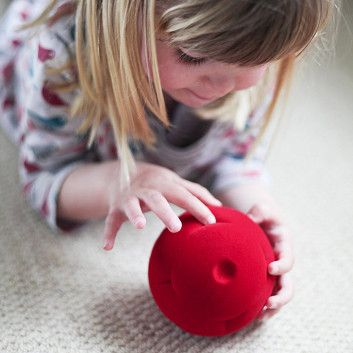 girl playing the Rubbabu button ball