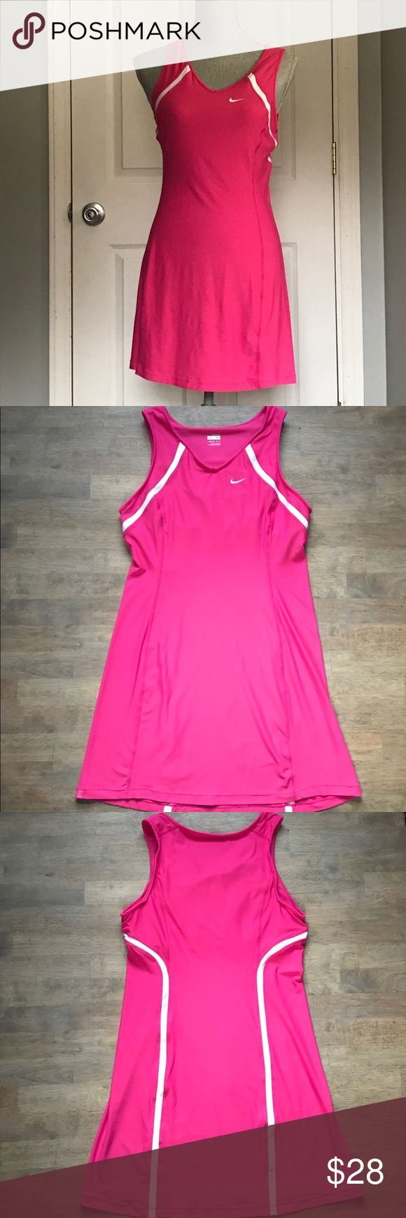 """Nike Fit Dry Tennis Dress Pink and White Nike Tennis Dress in Great Condition. No known stains or flaws. Dress has built in bra which I pictured. Size-M. Check out my closet for similar items. 🌻  Length- 31"""" Chest- 17"""" Nike Dresses Midi"""