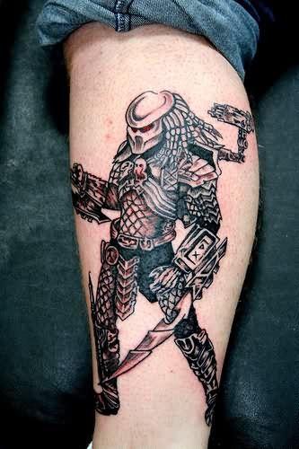 Alien Warrior Grey Ink Tattoo On Leg