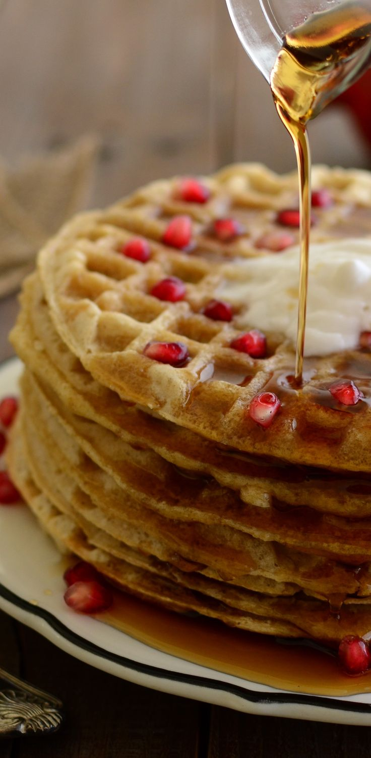 Simple oat waffles with just five ingredients. Served with juicy pomegranates and coconut whipped cream.