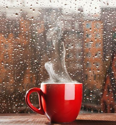 Bright red mug brings a smile and brightens the grey day...matching tea pot is filled with a spicy cinnamon blend...