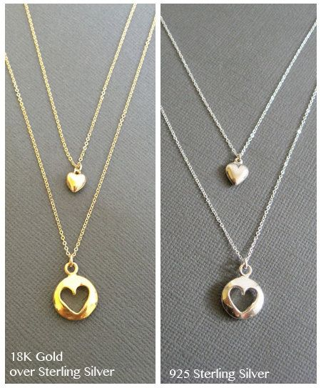 925 sterling silver/18K Gold over Sterling silver puffy cut out heart charm with puffy heart charm on a sterling silver/Gold filled chain and clasp. This is Two Separate Necklaces.  *Cutout puffy heart charm measures approx. 13mm *Puffy heart charm measures approx. 7mm ------------------------------------------------------------------------------------------  **Length of the necklace in the third picture is 17 + 19   **Available in Flat Heart Cut Out charm Necklace…
