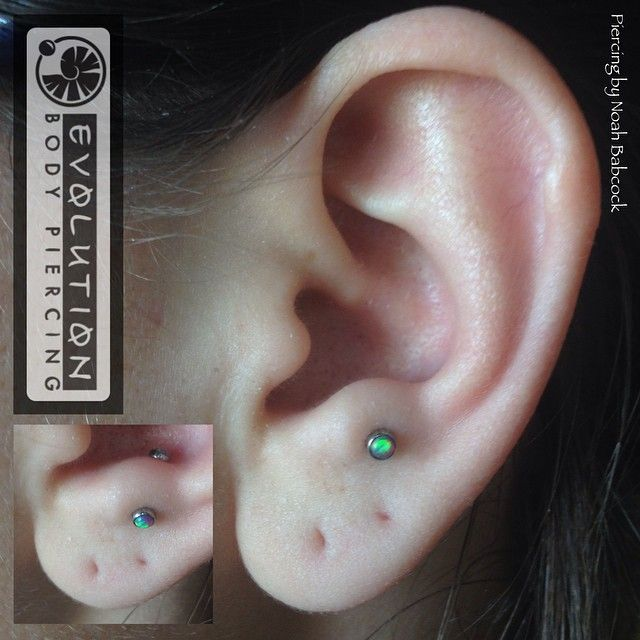 Healed anti-tragus piercing with opal and titanium jewelry by anatometal (at Evolution Body Piercing)