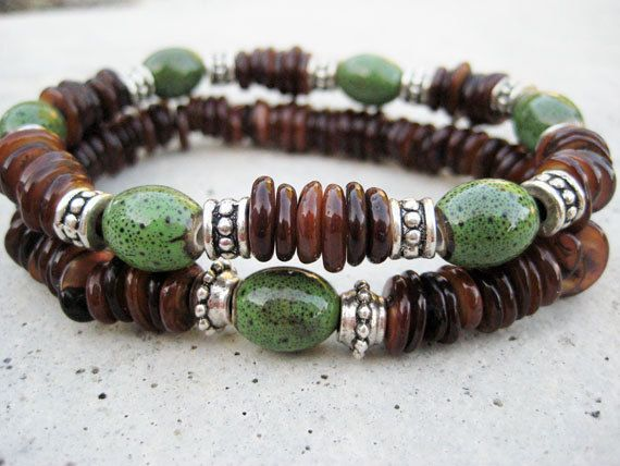 Two Bohemian beaded stretch bracelets featuring green ceramic barrel beads and 6mm amber mix shell beads.
