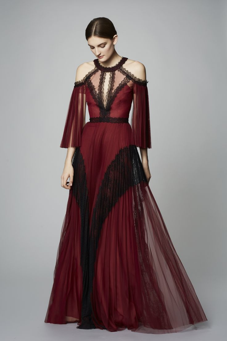Dress your bridesmaids in this stunning, cold shoulder tulle gown! Shop the look on Farfetch.com!