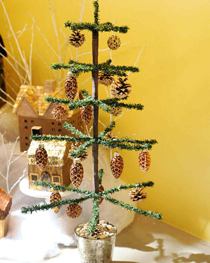Display special holiday ornaments on a sparkling tabletop tree made with tinsel.