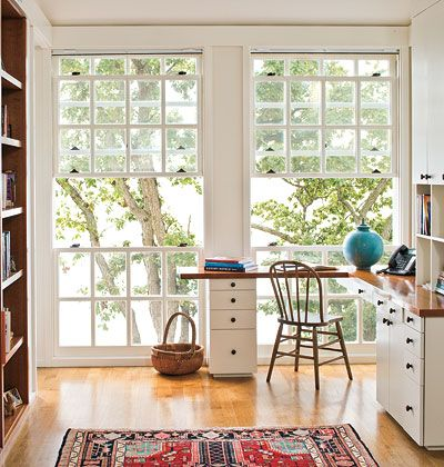 Modular, built-in shelving, an ample work surface, and clean-lined cabinets keep everything organized in this study.