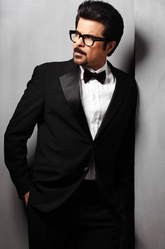 Anil Kapoor in a black suit. #Bollywood #Fashion #Style #Handsome