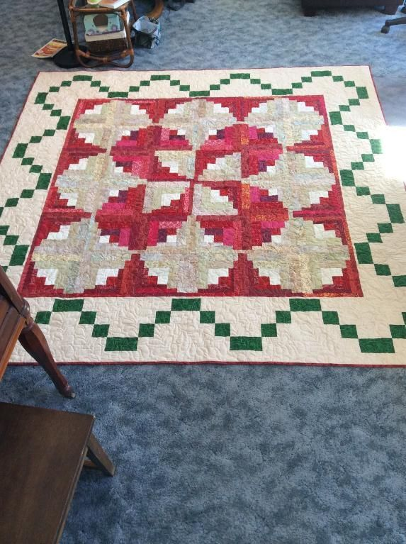 Looking for quilting project inspiration? Check out Curvy Log Cabin by member PattyAK.