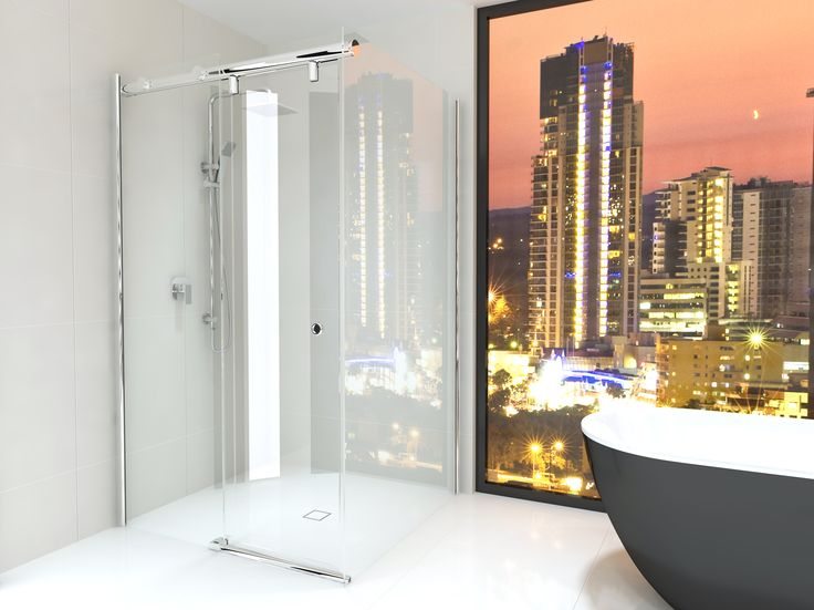 The black Yarra freestanding bath looking towards the skyscrapers headlines this Big-city style bathroom while the semi-frameless shower screen made with Australian standard toughened glass solidifies this sophisticated masterpiece.