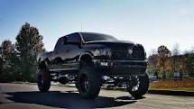 dodge ram 1500 jacked up with kc lights - Google Search