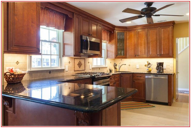 With seating for eight, the large dining table in the middle of this newly. kitchen cabinet showrooms near me en 2020