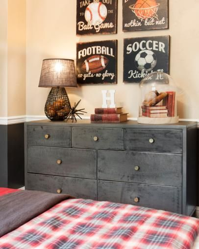 Kid's Bedroom With Retro Sports Art and Industrial Chest