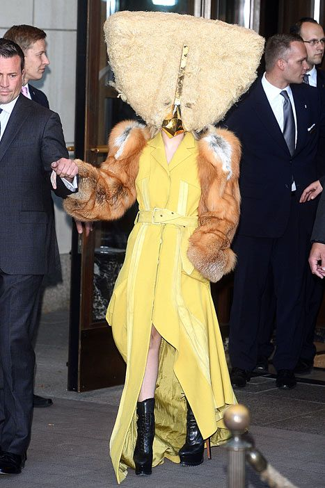Lady Gaga dressed up like a chicken in a giant furry mask and yellow dress while promoting her ARTPOP album in Berlin, Germany on Oct. 24.