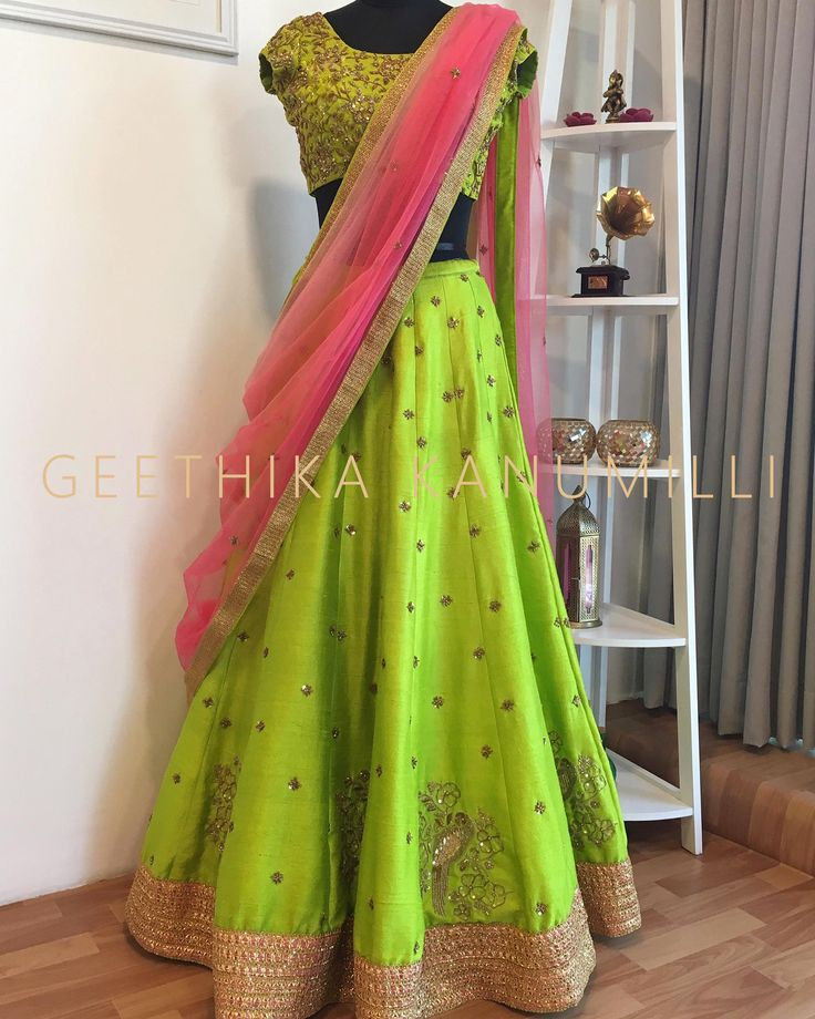 Look beautiful parrot green lehenga and designer blouse with pink color net duppata from Geethika Kanumilli. 04 June 2017