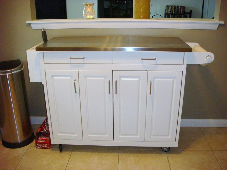White Kitchen Buffet table in Dawn's Garage Sale in Virginia Beach , VA for $200.00. Great condition.  Beautiful buffet table with wheels and stainless steel top with extended lip.