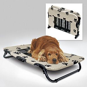 "Product # HC5251 - ELEVATED PET COT offers your dog a comfy place to rest - off of damp or buggy ground, cold floors or hot patios. Durable polyester cover features a nylon mesh insert at center that allows air to circulate and rain to drain off. Portable cot opens to a generous 24"" x 21"" x 6"" H; sturdy metal frame folds easily to store or transport.   $39.98"