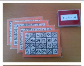 TAFELBINGO • Te gebruiken om 1) de maaltafels in te oefenen/te automatiseren of 2) een bingo met de klokjes. • Je hebt een bingo kaartjes en maaltafelkaartjes. Je kan een kind de leider laten zijn over een kleiner groepje, of zelf de leider zijn over een groter groepje.