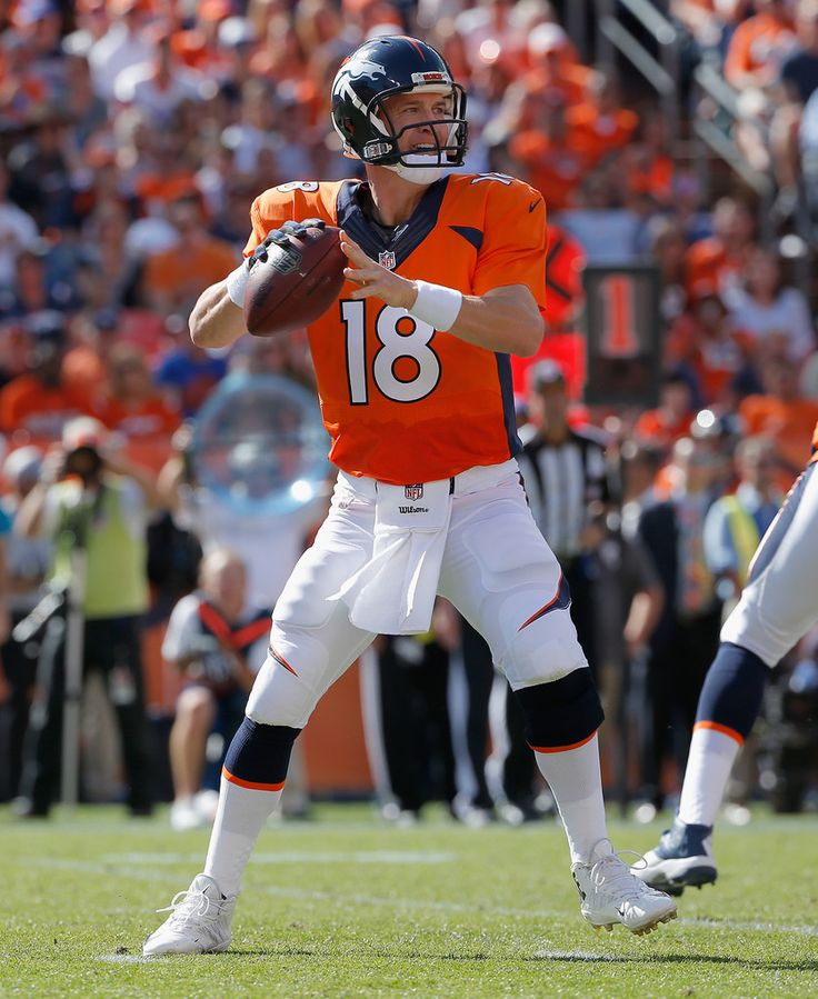 Quarterback Peyton Manning #18 of the Denver Broncos looks for a receiver against the Kansas City Chiefs at Sports Authority Field at Mile High on September 14, 2014 in Denver, Colorado.