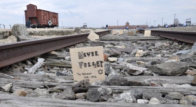 """The 21st March of the Living was held on April 19 at the former German Nazi concentration and extermination camp Auschwitz–Birkenau. The sound of the shofar gave the signal to begin the March from the gate with the inscription """"Arbeit macht frei"""". Participants walked in silence to Birkenau where the main ceremony was held near the ruins of the gas chambers and crematoria."""