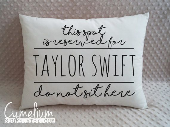 """A hand embroidered <a href=""""https://www.etsy.com/listing/267084687/taylor-swift-decorative-pillow-this-spot?ga_order=most_relevant"""