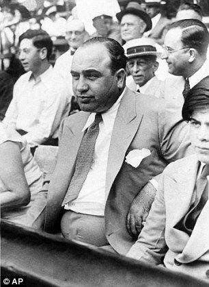 Al Capone attending a charity baseball match in Chicago.  The scar on his cheek can been seen clearly