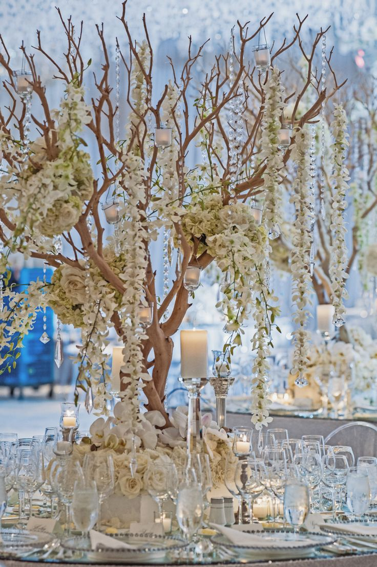 Manzanita tree centerpieces for a white wedding fall