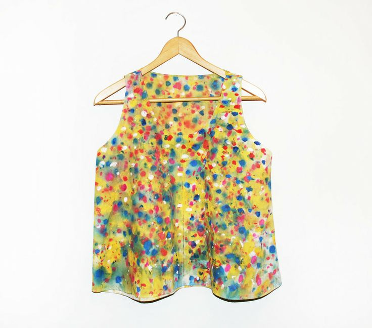 """""""Confetti Party"""" Hand Painted Tank Top $134.00 Various shades of primary color blobs graze the surface of this one of a kind top.  hand painted blouse made of cotton/poly blend. blouse drapes nicely off body, loose and slightly oversized fit.  hand wash by itself, air dry/line dry, iron to remove creases.  Handmade in California. http://shop.kindahkhalidy.com/"""
