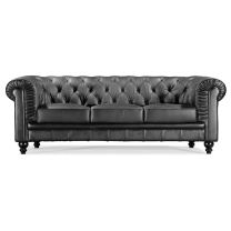 The Aristocrat sofa series, available in black or white leather or silver leatherette, features a tufted back and buttons. This elegant piece brings class and sophistication to the modern living room.