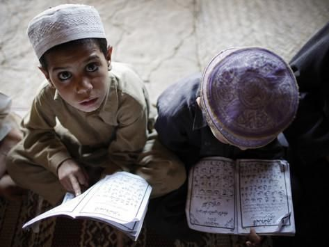 Afghan Refugee Children Read Verses of the Quran During a Daily Class at a Mosque in Pakistan Photographic Print at AllPosters.com