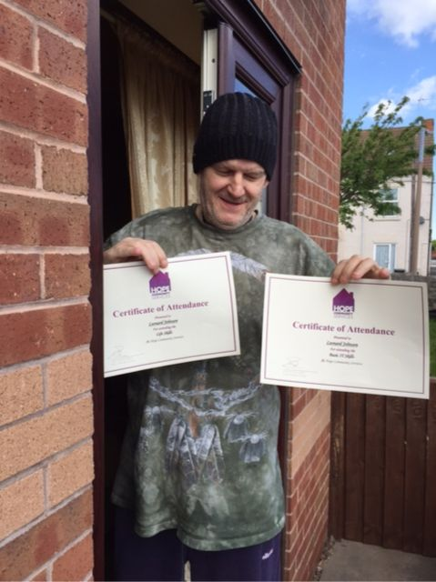 Len receiving his certificate for I.T training and basic life skills!