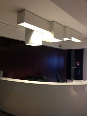 Welcome desk at CGI building in Montreal with LINK XXL sculptural ceiling light. A project by Lumigroup. http://www.vibia.com/en/lamps/show/id/00056/ceiling_lamps_link_xxl_design_by_ramon_esteve.html