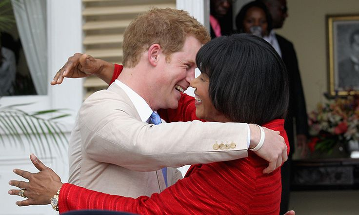 Prince Harry received a warm welcome from Jamaica's Prime Minister Portia Simpson Miller after he arrived in Kingston as part of the Queen's Jubilee Tour in 2012. <br>Photo: © Getty Images