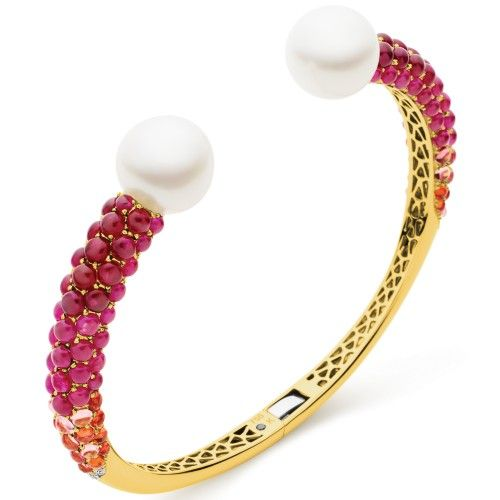 A fiery fusion of pink, orange and crimson light radiating from its meticulously set Cabochon rubies, sapphires, and tourmalines connects two spectacular, untreated Australian South Sea pearls. The Aurora Twin Pearl Cuff is a vibrantly coloured masterpiece of jewellery design, sure to attract attention whenever and wherever it is worn. View our collection of Australian South Sea pearls at www.rutherford.com.au