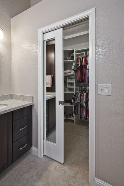 Mirrored pocket door - between bathroom & closet. Would love to do this with my space... and perhaps the door frame between the bathroom and bedroom.