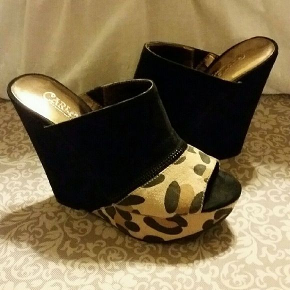 Black and Leopard Wedges/Mules Faux suede half black half leopard print wedges. Has rose design on the bottom. Really cute for going out and super comfortable. Paired with all black these look fierce. Worn twice. Carlos Santana Shoes Wedges
