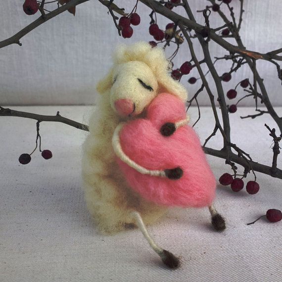 Needle felted dreaming sheep hugging light pink heart. This lovely sheep is made of 100% natural Bulgarian white and brown un-dyed wool. $42.00