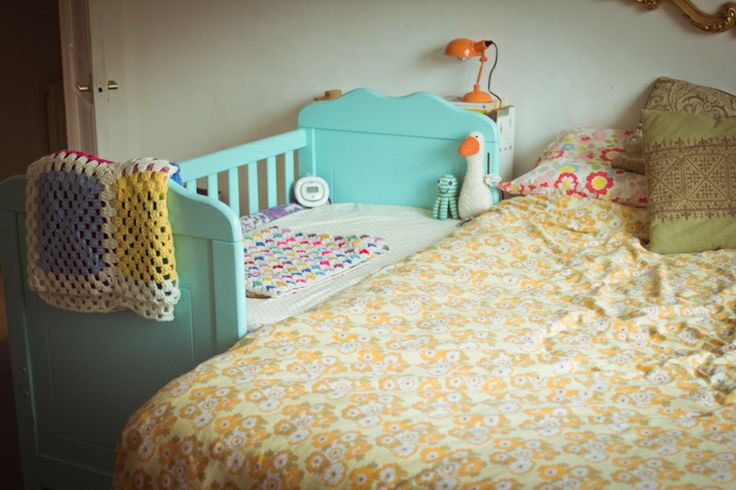 Real-life bedside crib set-up rather than a glossy catalogue photo!