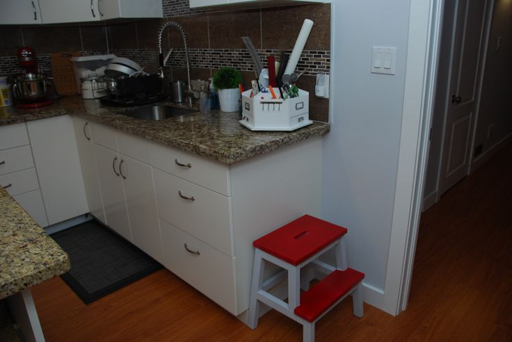 REpainted the IKEA Stool using the wall paint and RED spray paint