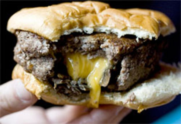Burger stuffed with American cheese and sauteed onions taken by Tina Wong. Tina Wong of The Wandering Eater features some cheese-laden burger porn in her review of the Stumble Inn, a restaurant that specializes in stuffed burgers, on the Upper...